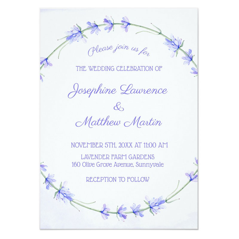 Wedding invitations with lavender flowers wreath on the front and a monogram on the back.