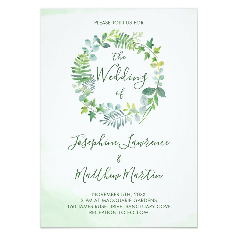 Greenery wedding invitations with a watercolor leaf wreath.
