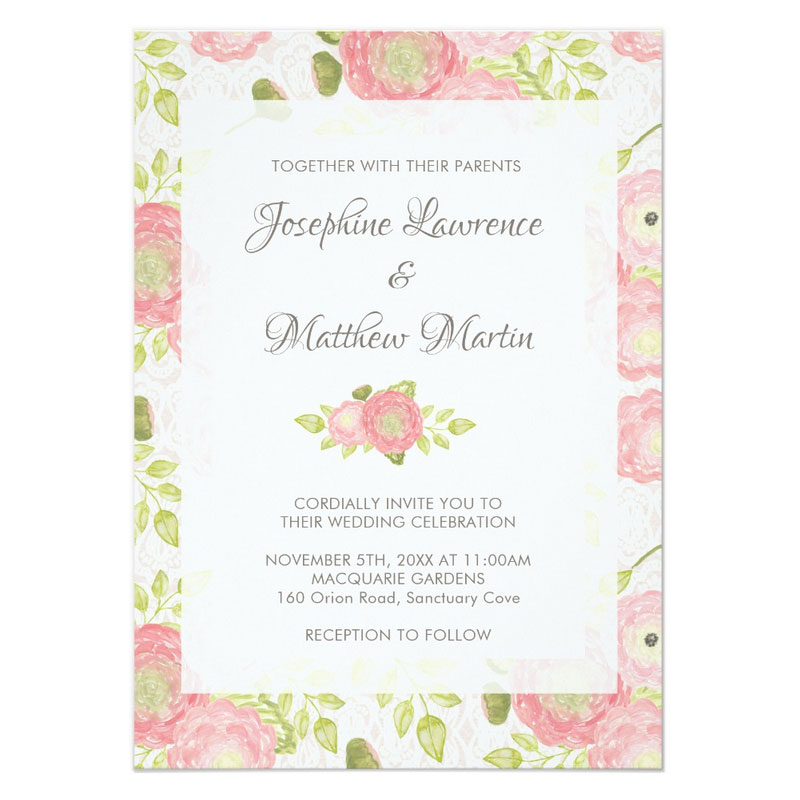 Ranunculus wedding invitations with peach ranunculus flowers on a lace background.