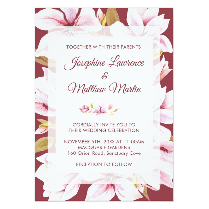 Romantic wedding invitations with elegant magnolias on a romantic deep red background.