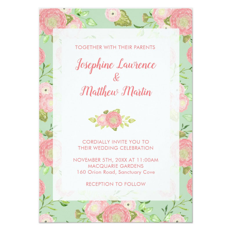 Unique spring wedding invitations featuring watercolor ranunculus flowers surrounding invitation text.