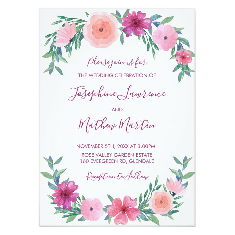 Watercolor floral wedding invitations with pink watercolor flowers and leaves.