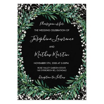 Wedding invitations with greenery and white flowers on a black background.