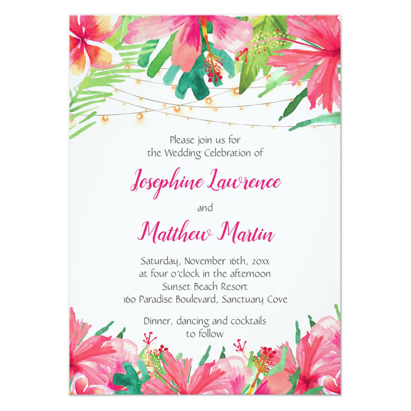 Tropical wedding invitation suite with hibiscus and plumeria flowers, tropical foliage and string lights.