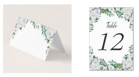 Wedding place card and table number card with white roses and foliage border design.