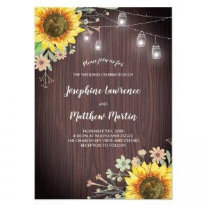 Rustic Sunflower wedding invitations with wood and mason jar lights.