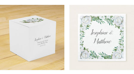 Wedding favor square box and wedding reception napkins with white rose and greenery design.
