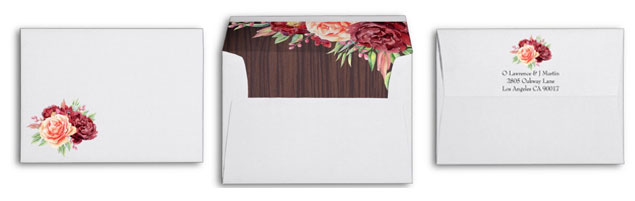 Matching envelopes for floral rustic wedding invitations with wood background inside.