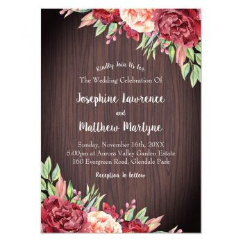Floral rustic wedding invitations with burgundy and blush roses on a wood background design.