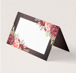 Floral rustic wedding place cards with wood background and watercolor flowers.
