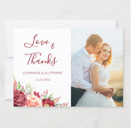 Wedding thank you cards with floral design and photo of the bride and groom.