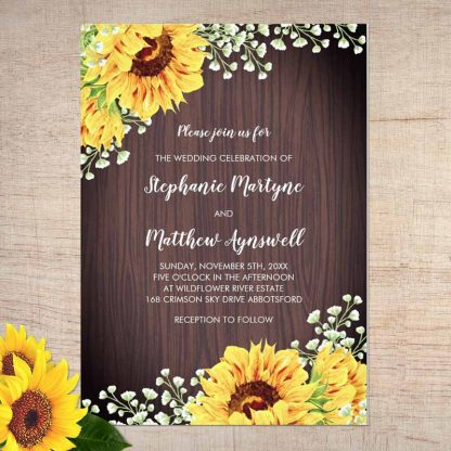 Rustic sunflower wedding invitations with baby's breath and wood grain.