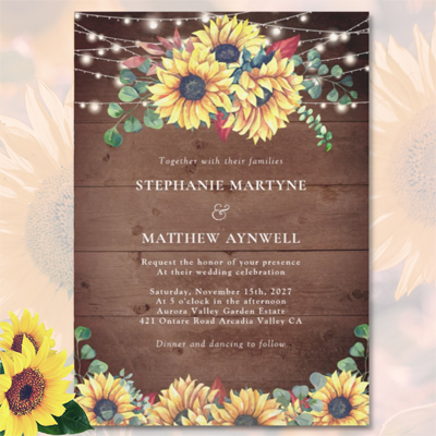 Rustic sunflower wedding invitations with string lighs and wood.