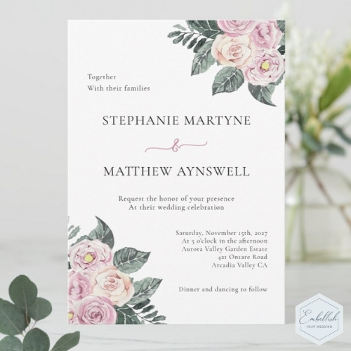 Dusty rose watercolor wedding invitations with dusty pink and blush roses and green foliage.