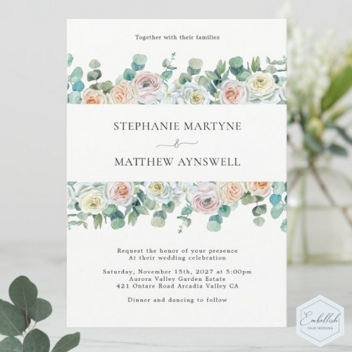 Dusty rose wedding invitations with eucalyptus leaves and watercolor roses.