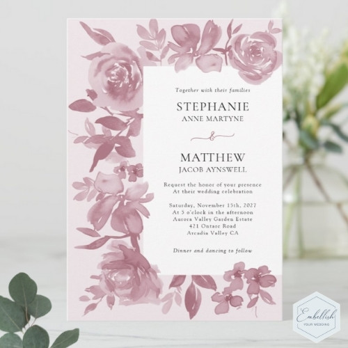 Dusty rose wedding invitations with watercolor design of roses and foliage.
